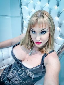Femdom Mistress Miranda sitting in the BDSM Laboratory, London