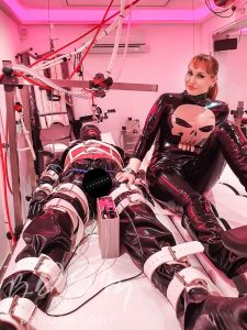 Slave strapped to a BDSM bench at the London BDSM Laboratory