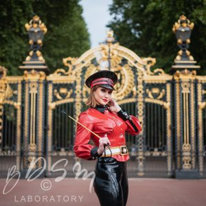 Mistress Miranda in front of Buckingham Palace, London dressed in latex catsuit for a Decadent London photoshoot.